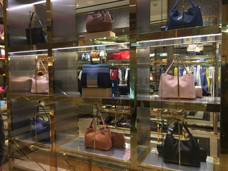 Bags in different shades and sizes at Kate Spade